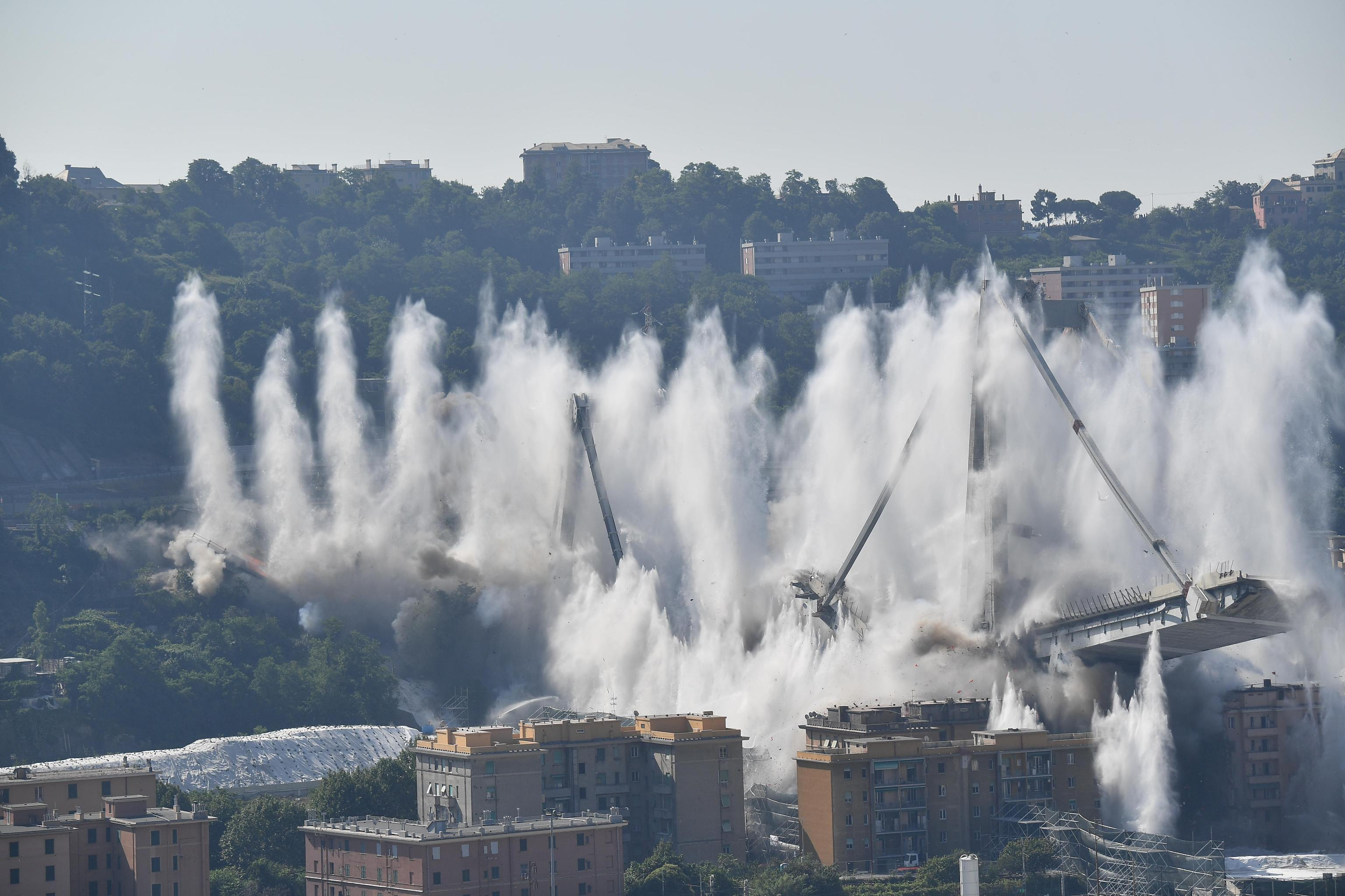 """A general view of the demolition """"pile"""" 10 and 11 Morandi bridge with micro-explosive charges, in Genoa, Italy, 28 june 2019. The new viaduct replacing the Morandi bridge is expected to be completed by  2020. The Morandi bridge partially collapsed on 14 august 2018 killing 43 people. ANSA/LUCA ZENNARO"""