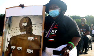 epa08631969 Dionne Smith holds a photo of her son James Rivera Lille who was shot 48 times by three Stockton, California police officers, on July 22, 2010 a day before his 17th birthday, at the site of the March on Washington at the Lincoln Memorial, in Washington, DC, 28 August 2020. Today marks the 57th anniversary of Rev. Martin Luther King Jr.'s I Have A Dream speech at the same location.  EPA/Michael M. Santiago / POOL