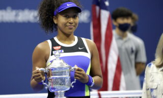 epa08665466 Naomi Osaka of Japan celebrates with the Championship Trophy after defeating Victoria Azarenka to win the Women's Final match on the thirteenth day of the US Open Tennis Championships the USTA National Tennis Center in Flushing Meadows, New York, USA, 12 September 2020. Due to the coronavirus pandemic, the US Open is being played without fans and runs from 31 August through 13 September.  EPA/JASON SZENES